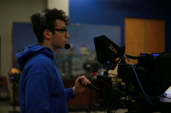 A student recording a video segment in the broadcast studio